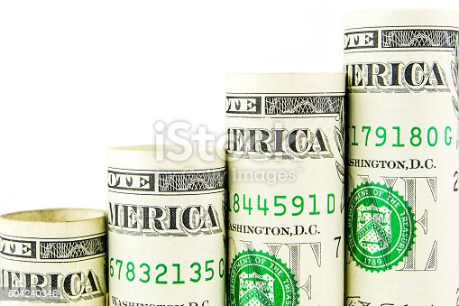 rising steps made of one american dollar banknotes on white bakground