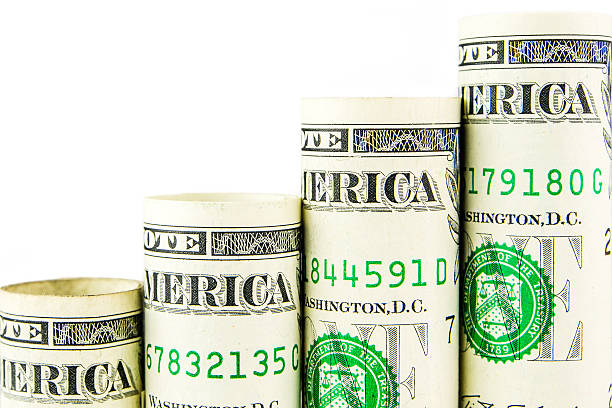 rising steps made of one american dollar banknotes - wages stock photos and pictures