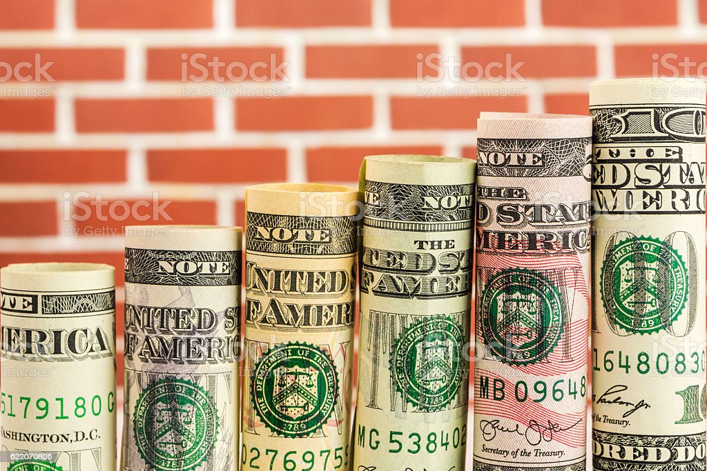 rising steps made of rolls of all american dollar banknotes stock photo