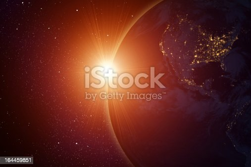 Rising sun behind planet, digitally generated image, all graphics elements are my own design/photo.