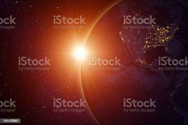 Photo of Rising sun behind planet