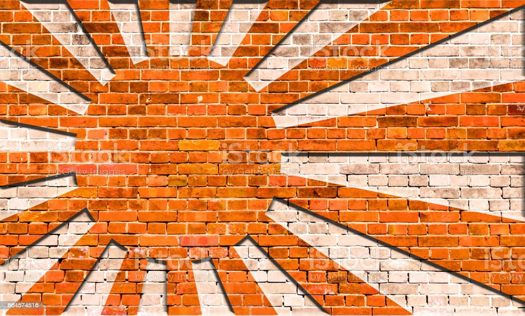 Rising Sun Flag on Brick wall stock photo