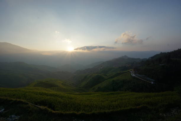 Rising sun on Longsheng terraced rice fields stock photo