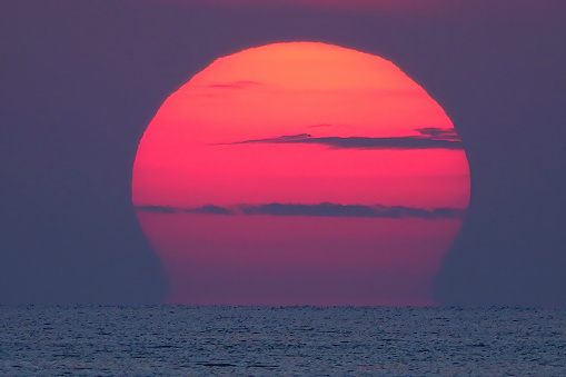 rising sun over the sea in the early morning