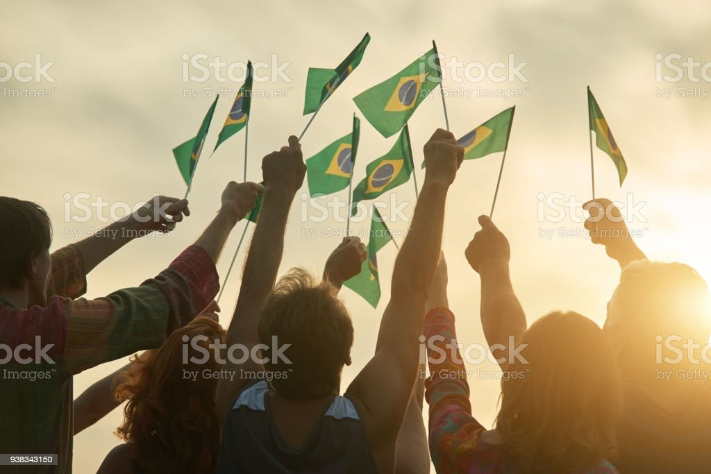 Rising up brazil flags. stock photo