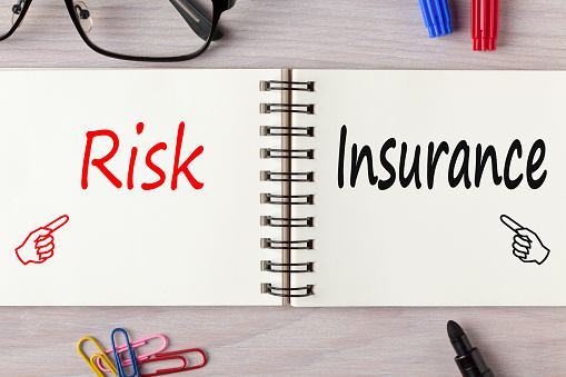 istock Risk and Insurance written on notebook concept 930012180