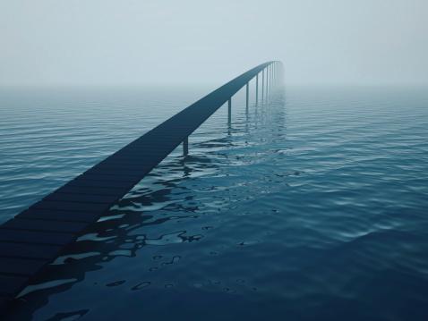 Narrow bridge over sea (risk concept)