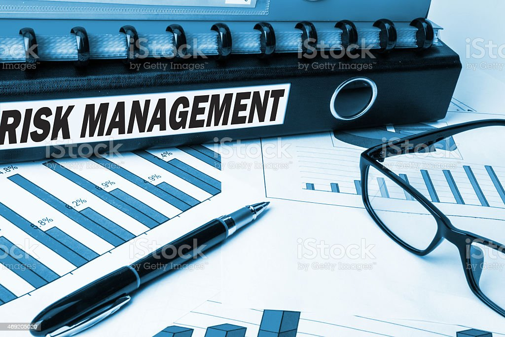 risk management label on folder stock photo
