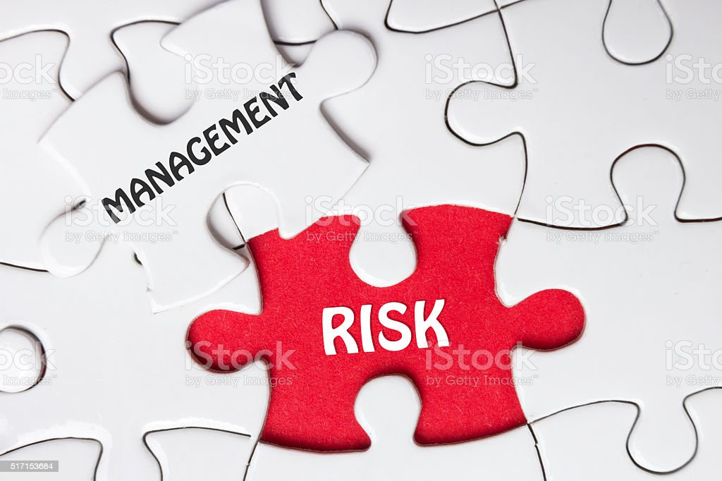 Risk Management. Missing jigsaw puzzle pieces with text stock photo