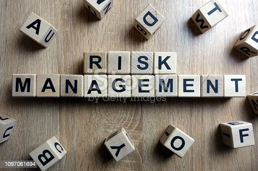 1160751010 istock photo Risk management text from wooden blocks 1097061694