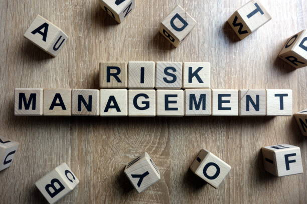 Risk management text from wooden blocks stock photo