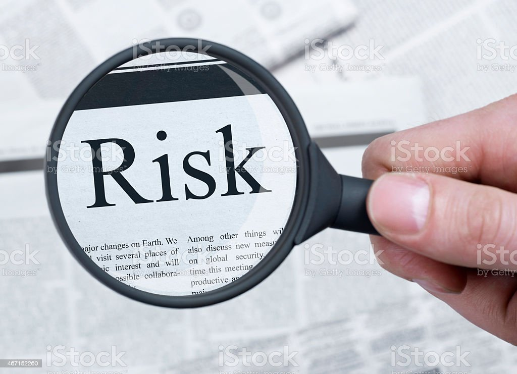 Risk under magnifying glass Risk word under magnifying glass 2015 Stock Photo