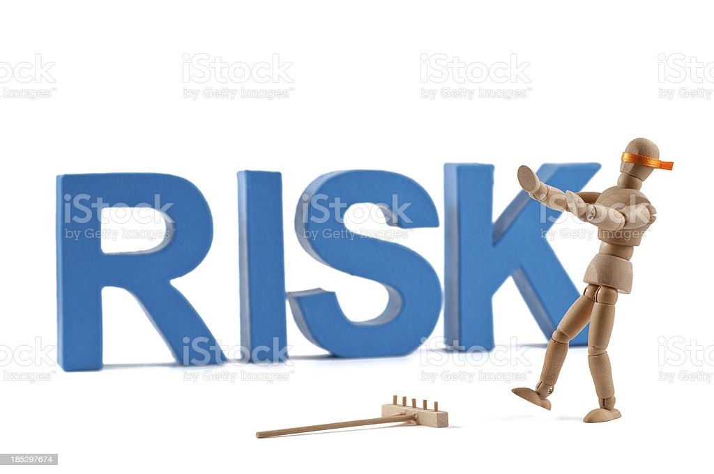 Risk - Wooden Mannequin demonstrating this word stock photo