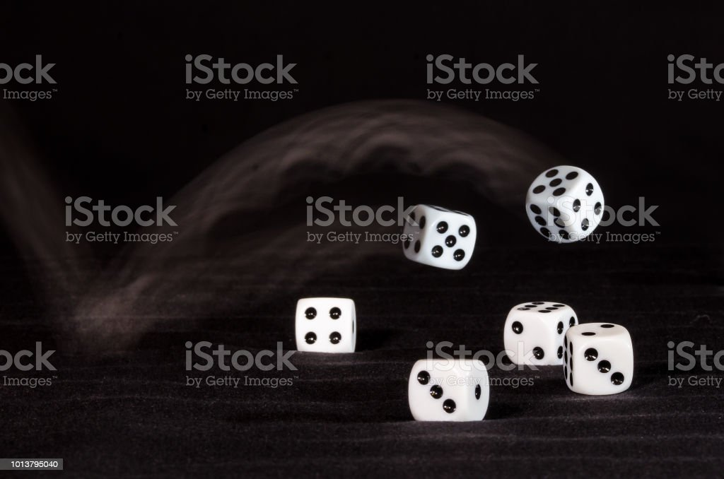Risking All On A Roll Of The Dice Stock Photo - Download