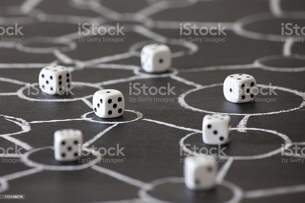 Risky business: group of dices on a network royalty-free stock photo