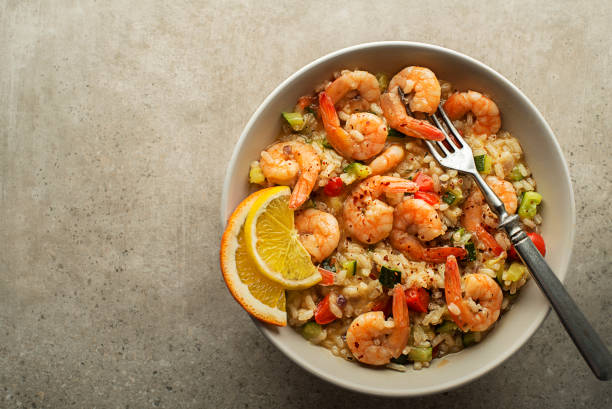 Risotto meal with grilled shrimps stock photo