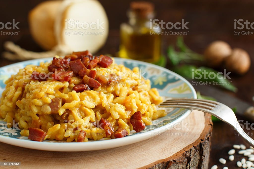 Risotto with a pumpkin and bacon stock photo
