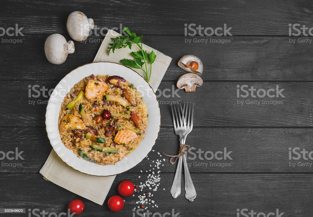 risotto with chicken meat and mushrooms stock photo