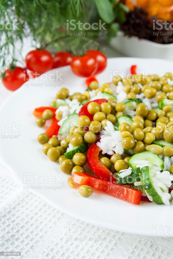 Risotto with fresh cucumber, radishes, pepper and green peas royalty-free stock photo