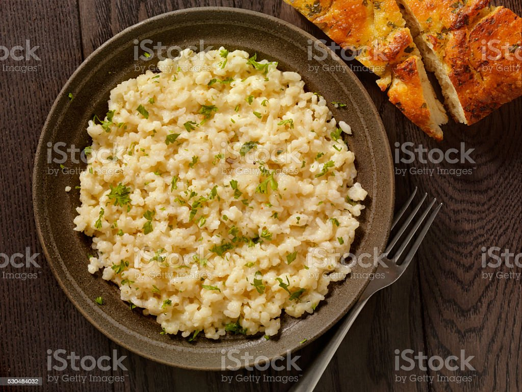 Risotto with Fresh Parsley and Focaccia Bread stock photo