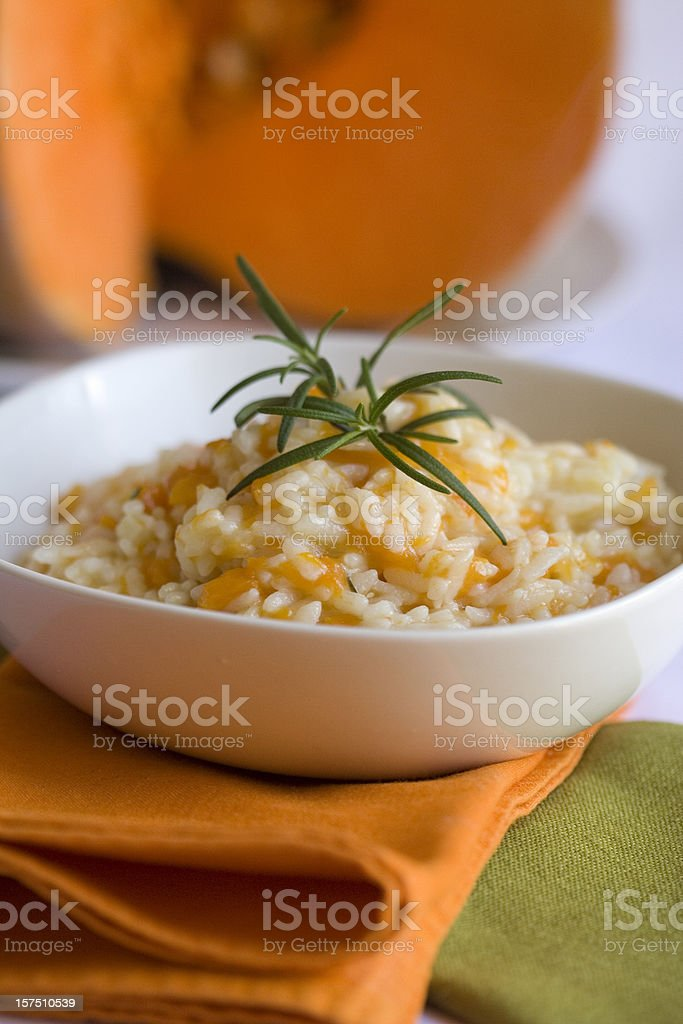 Risotto with Pumpkin and Rosemary in a White Bowl royalty-free stock photo