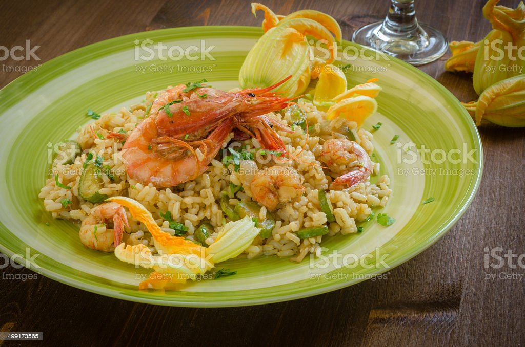 Risotto with shrimps and zucchini royalty-free stock photo