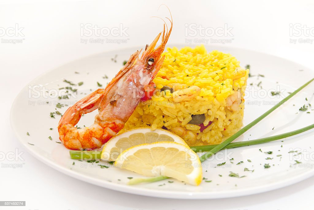 Risotto with shrimps Rissotto with shrimps served with lemon and gourmet. Cooked Stock Photo