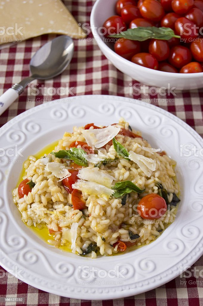 Risotto with tomatoes and basil royalty-free stock photo
