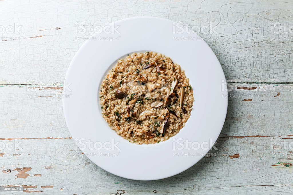 Risotto with wild mushrooms cep boletus stock photo