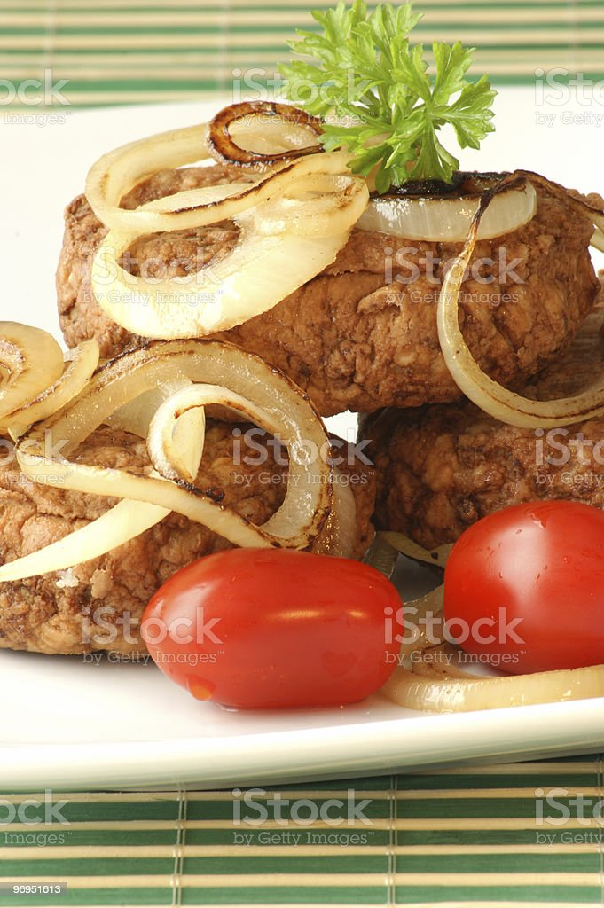 rissole with grilled onion and organic tomato royalty-free stock photo