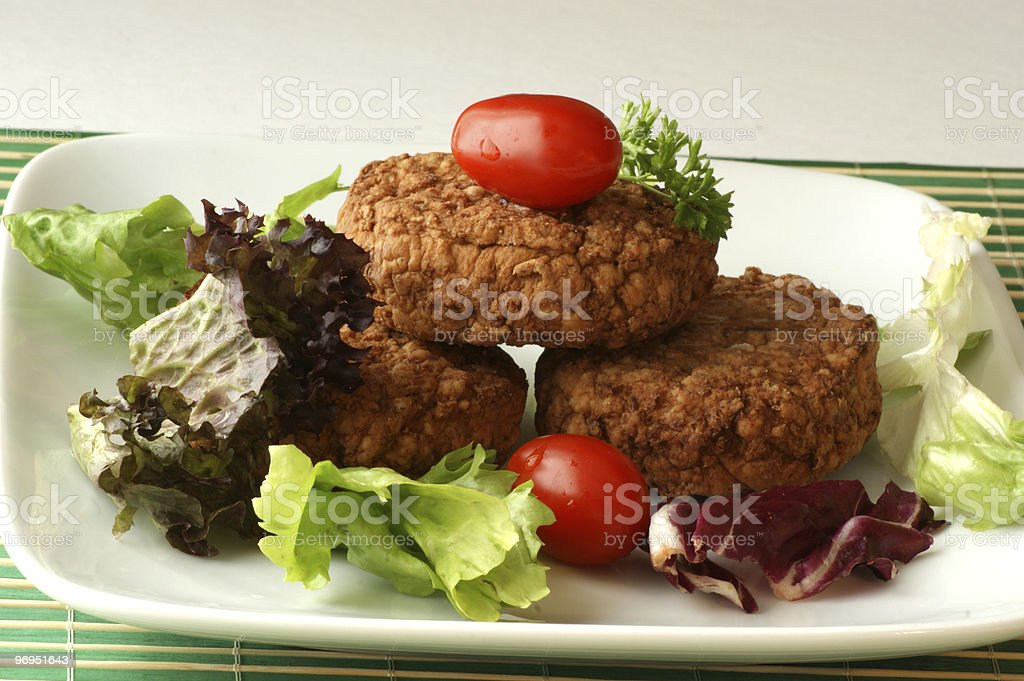 rissole with plum tomato and salad on a plate royalty-free stock photo