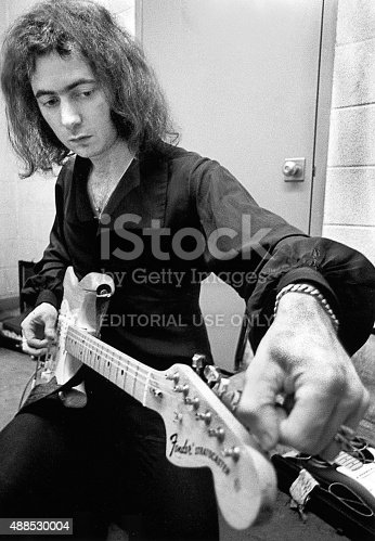 West Palm Beach, FL – MARCH 24, 1971: Deep Purple guitarist Ritchie Blackmore tunes up his guitar before a concert in West Palm Beach; Florida.