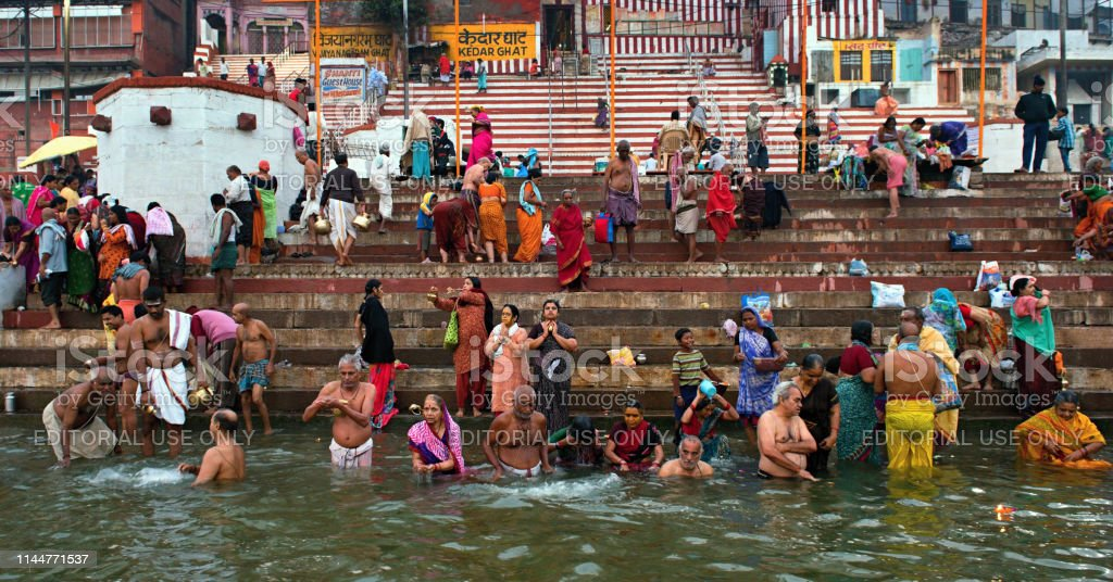 Ritual Bath In The Sacred Ganges River Stock Photo