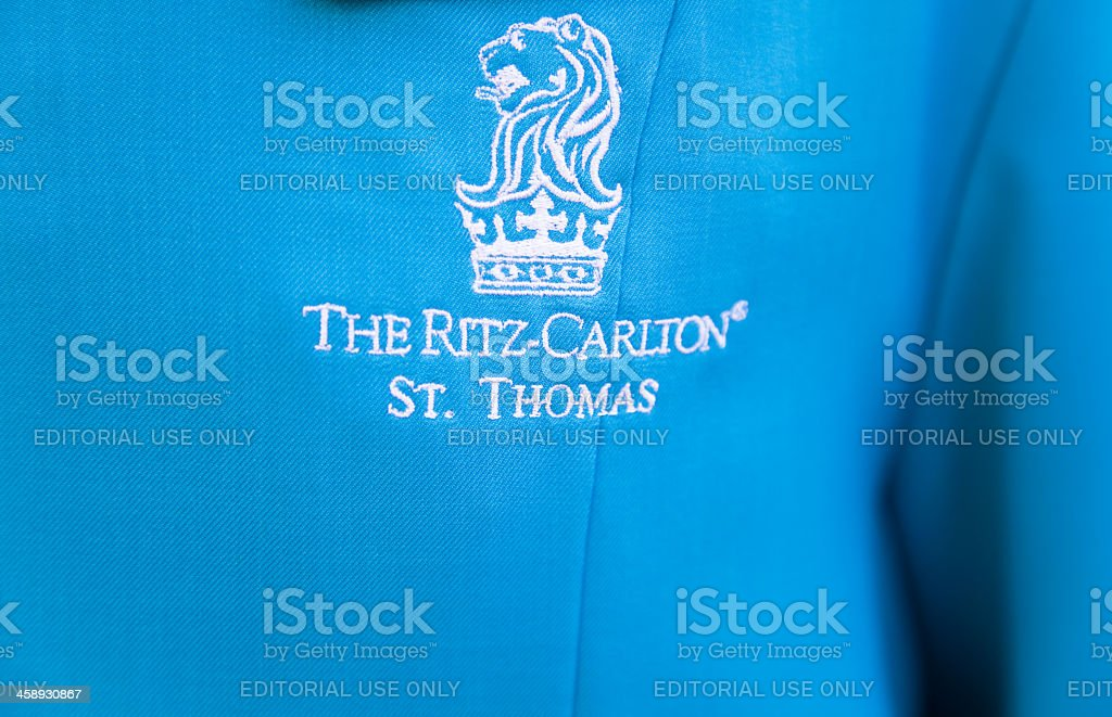 Ritz - Carlton St Thomas logo on  bell hop's uniform royalty-free stock photo