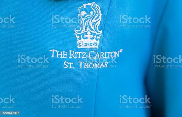 Ritz carlton st thomas logo on bell hops uniform picture id458930867?b=1&k=6&m=458930867&s=612x612&h=rqp035tkdtu6rromde9quywdxlzu2dr8v6z dzbfv0g=