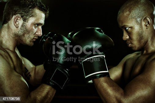 497607484 istock photo rival boxers faceoff 471708735