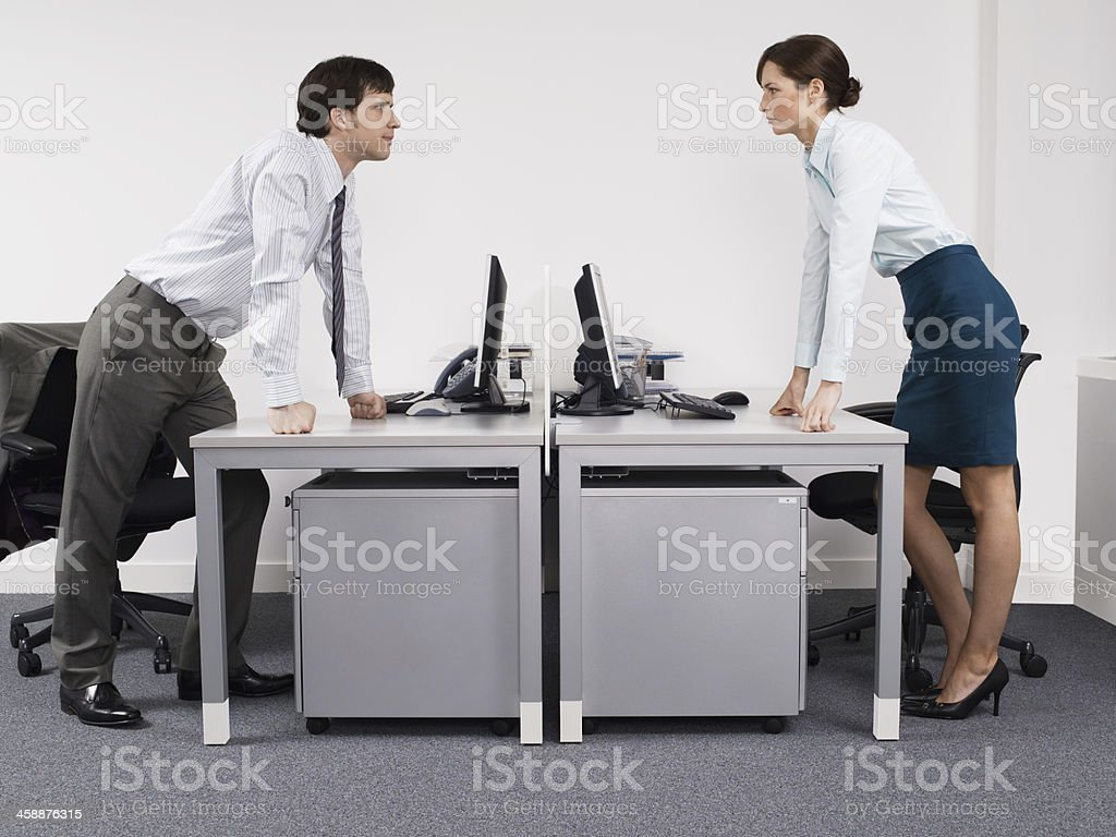 Rival Business Colleagues In Office stock photo