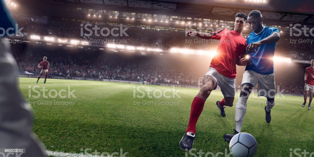 Rival Soccer Players in Challenge for Possession Of Football stock photo