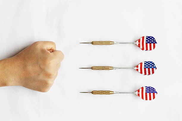 rivalry There are 3 darts,they are fighting the fist. antagonize stock pictures, royalty-free photos & images