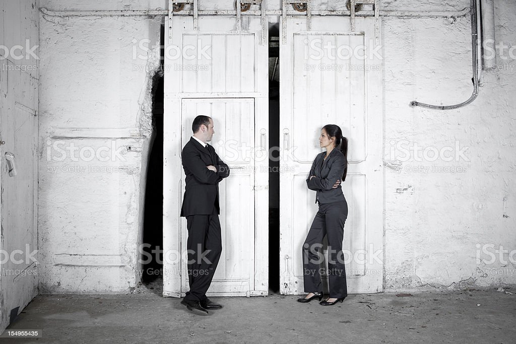 Rivalry - two business people stock photo