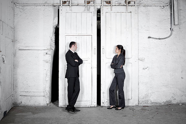rivalry - two business people - battle of the sexes concept stock pictures, royalty-free photos & images