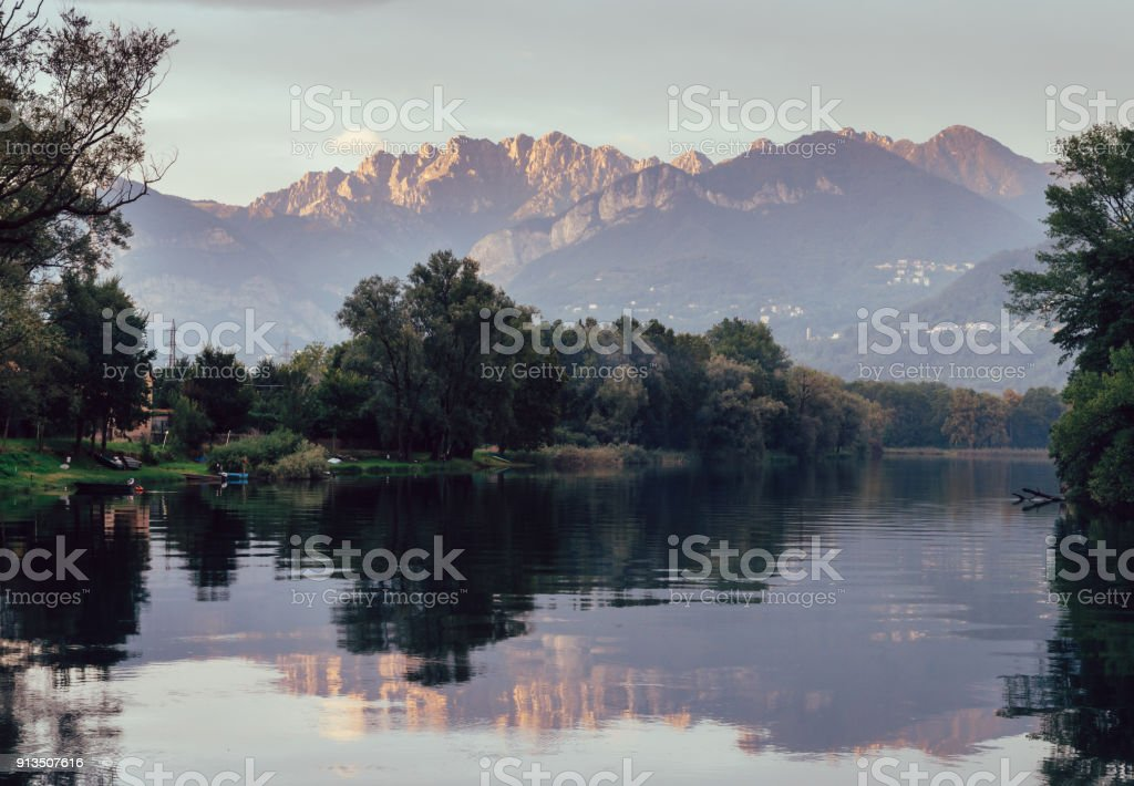 River Adda in northern Italy, close to Lake Como at sunset - fine art wall hanger style stock photo