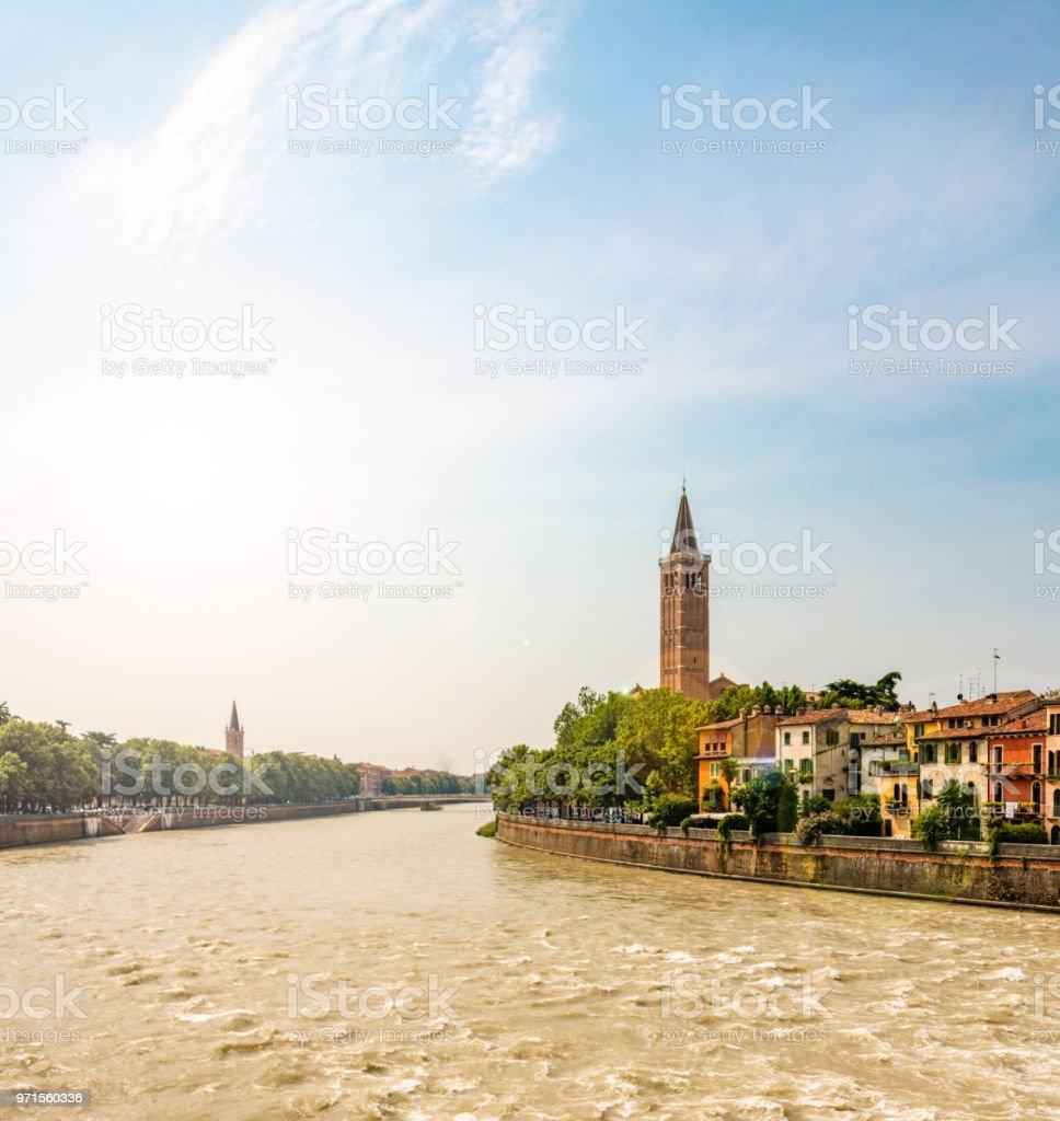 River Adige, tower of Santa Anastasia church and wider city of Verona, Italy stock photo
