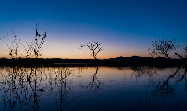 River after the sunset with blue and orange sky stock photo