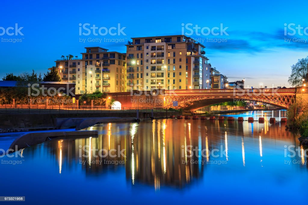 River Aire and bridge in Leeds city centre at night stock photo