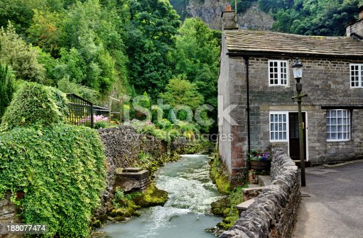 View of a stone built cottage by a river in the village of Castleton,Edale, in