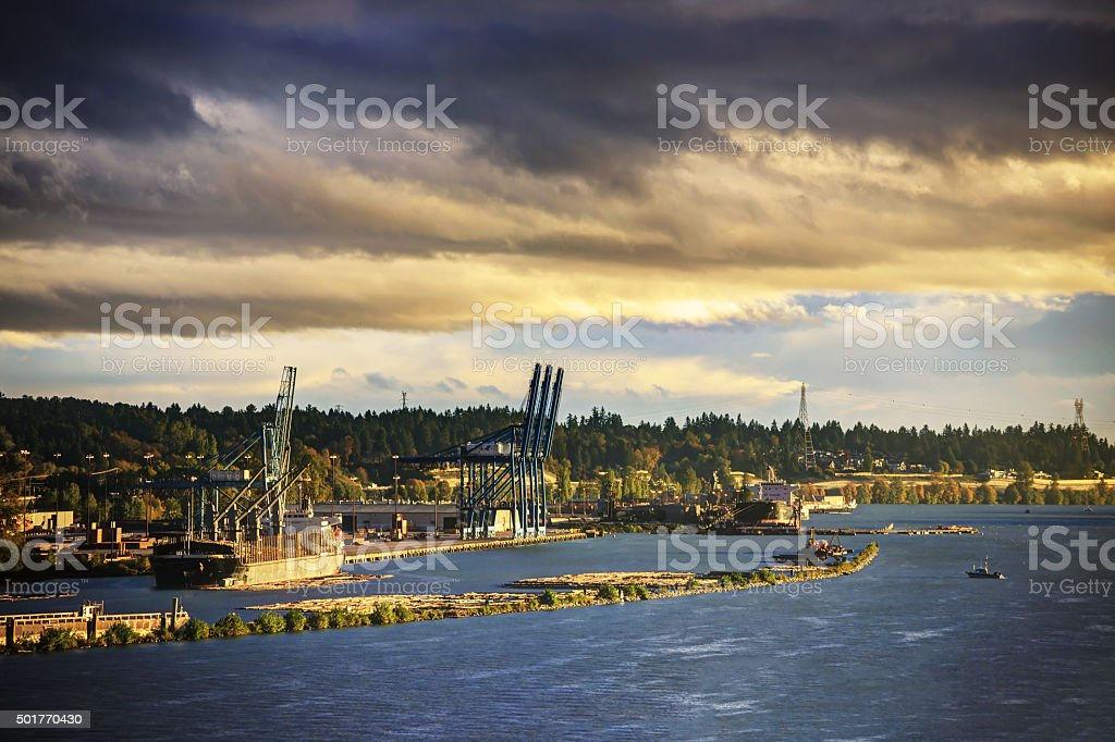 river and harbor at sunset stock photo