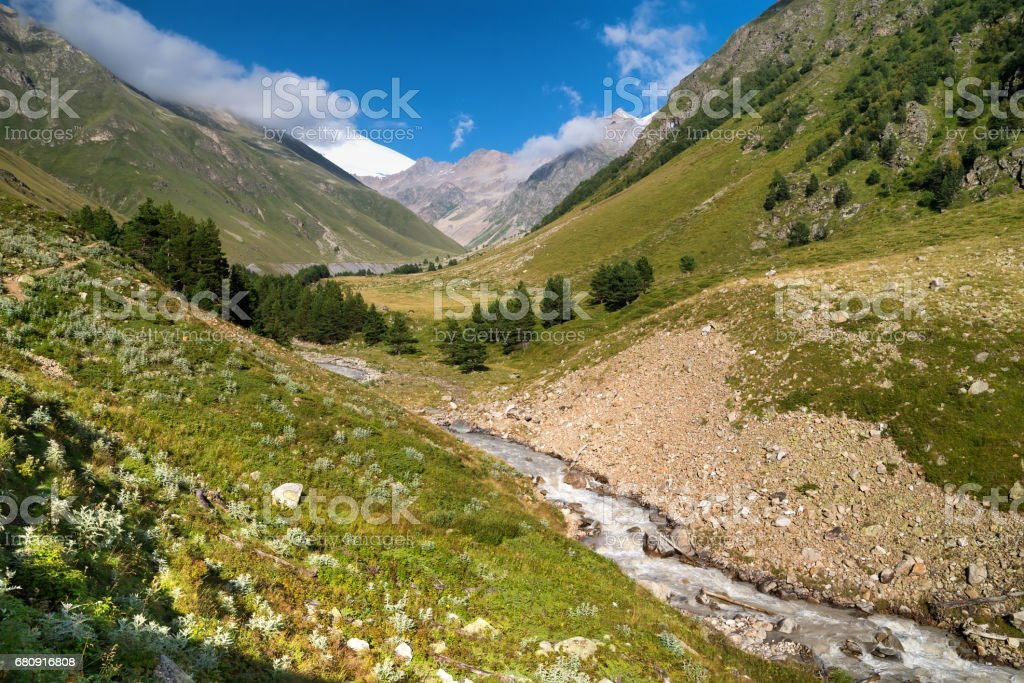 River and high mountains. Beautiful natural landscape in the summer time royalty-free stock photo