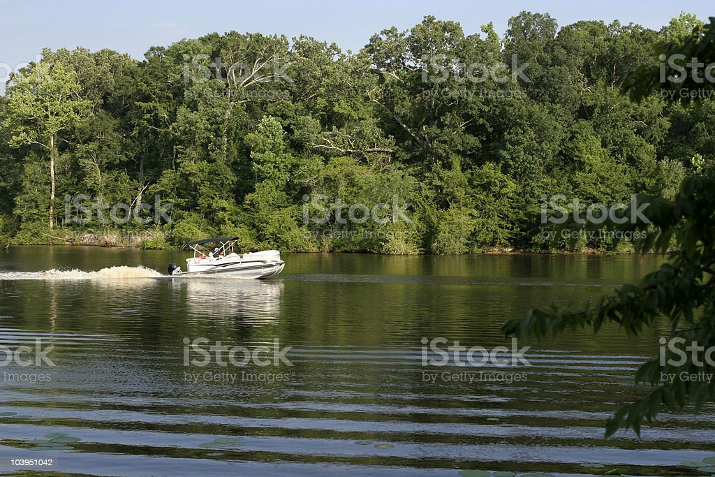 River and lake landscape with party barge stock photo