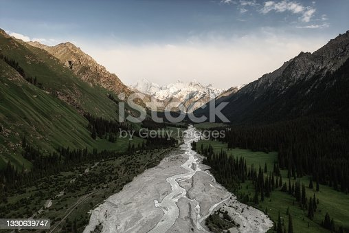 istock River and mountains with white clouds. 1330639747